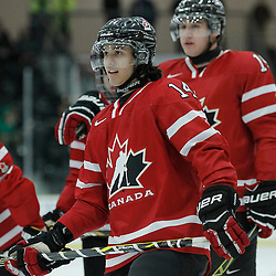 COBOURG, - Dec 16, 2015 -  Game #9 - Canada East vs Canada West at the 2015 World Junior A Challenge at the Cobourg Community Centre, ON. Justin Fregona #14 of Team Canada West during the pre-game warmup<br /> (Photo: Amy Deroche / OJHL Images)