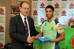 James Bevan, British High Commissioner to India handing over Olympics 2012 merchandise to Siddharth Mallya during match 62 of the the Indian Premier League ( IPL) 2012  between The Royal Challengers Bangalore and the Mumbai Indians held at the M. Chinnaswamy Stadium, Bengaluru on the 14th May 2012..Photo by Prashant Bhoot/IPL/SPORTZPICS