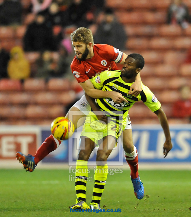 Picture by Richard Land/Focus Images Ltd +44 7713 507003<br /> 14/12/2013<br /> Martin Cranie of Barnsley and Joel Grant of Yeovil Town battle for the ball during the Sky Bet Championship match at Oakwell, Barnsley.