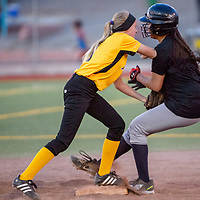 Pirate Graciela SIlva (3) tags Tiger Ash Samuels (0) as Samuels tags up on second base Tuesday at Ford Canyon Park.