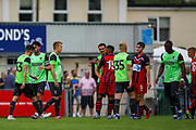 AFC Wimbledon players at the end of the match during the Pre-Season Friendly match between Hampton & Richmond and AFC Wimbledon at Beveree Stadium, Richmond Upon Thames, United Kingdom on 27 July 2019.