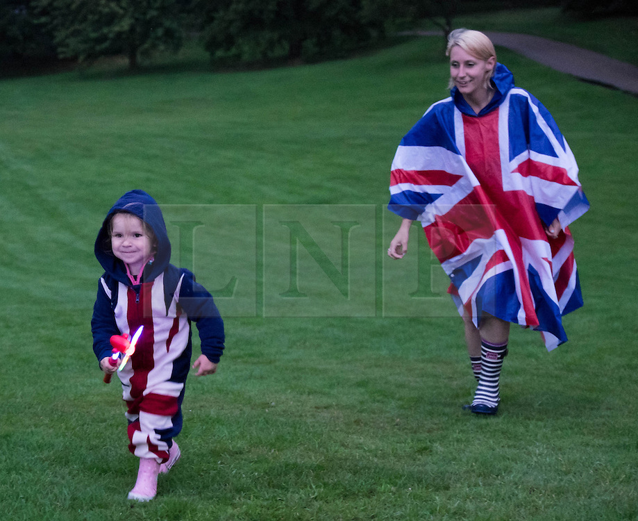 © Licensed to London News Pictures.22/08/15<br /> Castle Howard, North Yorkshire, UK. <br /> <br /> AVA MICKELWRIGHT, 2, wears a Union Flag onesy  as she plays on the lawns of Castle Howard during the 25th anniversary of the Castle Howard Proms event near York. The theme of the event this year is a commemoration of the 75th anniversary of the Battle of Britain and the 70th anniversary of VE day and brings an evening of classic musical favourites celebrating Britishness to the lawns of Castle Howard.<br /> <br /> Photo credit : Ian Forsyth/LNP