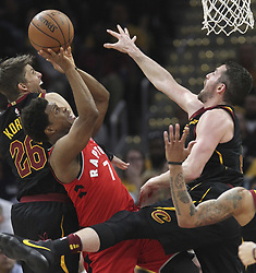 May 7, 2018 - Cleveland, OH, USA - Toronto Raptors' Kyle Lowry is smothered inside during the first quarter by Cleveland Cavaliers' Kyle Korver (left) and Kevin Love in Game 4 of a second-round playoff series on Monday, May 7, 2018 in Cleveland, Ohio. (Credit Image: © Phil Masturzo/TNS via ZUMA Wire)