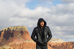 man in a hoody walking in The Southwest landscape