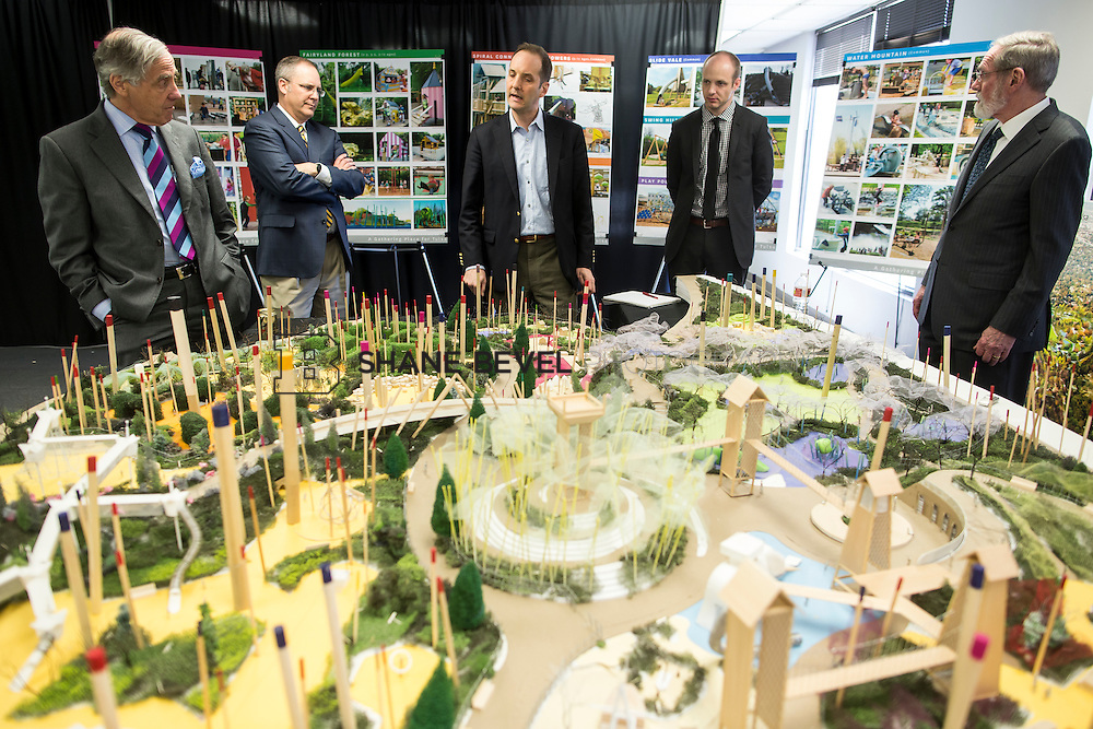 4/4/14 2:14:19 PM -- Jeff Stava, Phil Lakin and Fred Dorwart and George Kaiser meet with representatives of the design team to discuss new models showing the play areas and lodge area of A Gathering Place for Tulsa. <br /> <br /> Photo by Shane Bevel