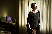 "PENSACOLA, FL – FEBRUARY 19, 2018: Betsy LeGallais, 54, stands in the living room of her Pensacola home. LeGallais estimates she and her mother have spent $120,000 over the years on addiction treatment for her now 25-year-old daughter, Anna Lewis, who first encountered opiates through prescription drugs during high school. Her daughter's opioid addiction quickly led to heroine use, then alcohol, and a few months ago co-payments for Ms. Lewis's latest round of detox took what little savings Ms. LeGallais had begun to build back up again. Despite the financial hardship, LeGallais is still hopeful. ""Anna sought help on her own,"" she said, ""so I fully support her in her journey to sobriety. It's nothing to be ashamed of anymore. This is a true disease."" <br /> <br /> The addiction crisis that is killing tens of thousands of Americans every year is also creating a financial crisis for many families, compounding the anguish caused by a loved one''s destructive illness. Families are burning through savings and amassing huge debt paying for rehab that often doesn't work. According to the Substance Abuse and Mental Health Services Administration, federal data show that 22.5% of admissions for substance-abuse treatment involve someone who's already had one previous round of treatment, and another 21% involve people who ha've had two or three previous rounds. The predicament reflects both the difficulty of treating addiction, and the haphazard rehabilitation and insurance system many patients face. <br /> CREDIT: Bob Miller for The Wall Street Journal"