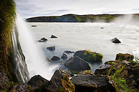 A small waterfall flows into river Þjórsá just above Urriðafoss waterfall, South Iceland.