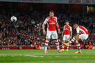 Alexis Sanchez of Arsenal (right) scores the opening goal against Southampton during the Capital One Cup match at the Emirates Stadium, London<br /> Picture by David Horn/Focus Images Ltd +44 7545 970036<br /> 23/09/2014