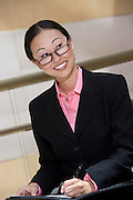 Business woman smiling and writing notes