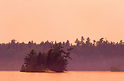 Trees on island in Lake of the  Woods at sunset<br /> Sioux Narrows Provincial Park<br /> Ontario<br /> Canada