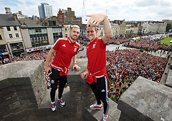 CARDIFF, WALES - Friday, July 8, 2016: Wales' Aaron Ramsey and Chris Gunter take a selfie on top of Cardiff Castle ramparts as the team arrive back home in Cardiff after their Semi-Final of the UEFA Euro 2016 Championship. (Pic by David Rawcliffe/Propaganda)