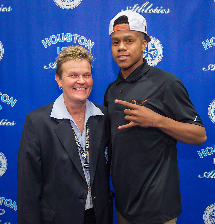 Houston ISD Athletic Director Marmion Dambrino poses for a photograph with Yates' Jacob Young during National Signing Day ceremonies for student athletes at the Pavilion at Forest Brook Middle School, February 3, 2016.