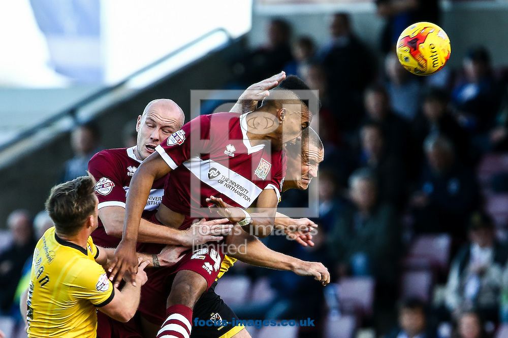 Ivan Toney of Northampton Town (centre) heads towards goal during the Sky Bet League 2 match at Sixfields Stadium, Northampton<br /> Picture by Andy Kearns/Focus Images Ltd 0781 864 4264<br /> 01/11/2014