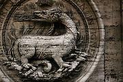 Rome, Italy, November 7, 2004-A dragon sculpted on the facade San Luigi Francese church.