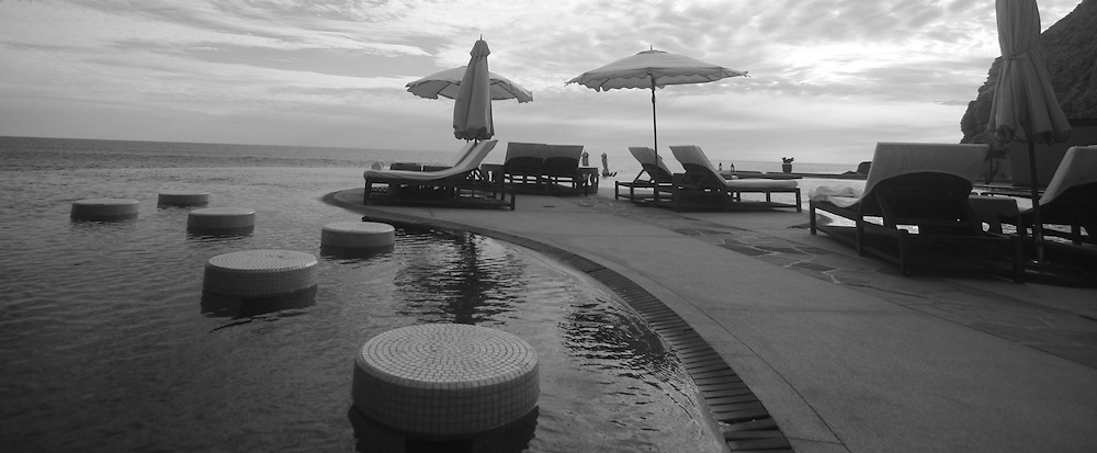 Pool and lounge area, black & white