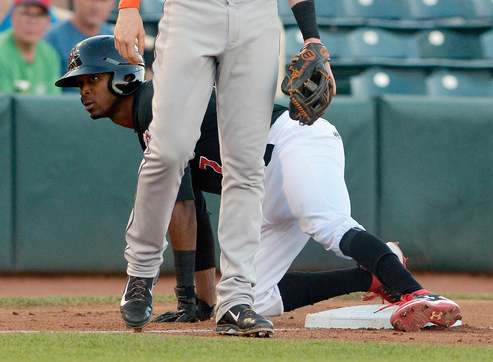 gbs061317q/SPORTS -- The Isotopes' Rosell Herrera, 7, gets up stealing third base during of the game against Fresno in Isotopes Park on Tuesday, June 13, 2017. (Greg Sorber/Albuquerque Journal)