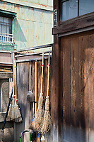 Straw Brooms on Fence at Shitaya Jinja Shinto Shrine