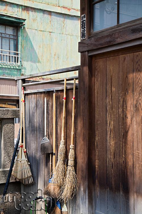 Straw Brooms on Fence at Shitaya Jinja Shinto Shrine