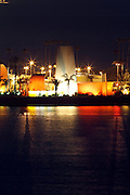 Night photograph of an oil pumping station in Long Beach Harbor from the roof of the Ocean Club condominium building on the night of a full moon on May 5, 2012 in Long Beach, California. ©Paul Anthony Spinelli
