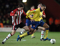 Photo: Richard Lane.<br />Southampton v Arsenal. Barclaycard Premiership.<br />29/12/2003.<br />Thierry Henry breaks away from Rory Delap.