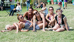 © Licensed to London News Pictures. 25/06/2015. Pilton, UK. A group of female festival goers at Glastonbury Festival 2015 practice dancing like Lionel Richie in advance of a Dance Like Lionel flashmob about to take place - Lionel Richie is performing on the main stage on Sunday. It is Thursday Day 2 of the festival.  This years headline acts include Kanye West, The Who and Florence and the Machine, the latter having been upgraded in the bill to replace original headline act Foo Fighters.   Photo credit: Richard Isaac/LNP
