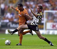 Photo: Greig Cowie.<br /> 08/08/2003.<br /> Pre-Season Football Friendly. Wolverhampton Wanderers v Boavista.<br /> Wolve's Silas takes on Raul Meireles