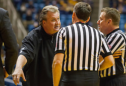 Jan 26, 2016; Morgantown, WV, USA; West Virginia Mountaineers head coach Bob Huggins speaks with the officials during a timeout against the Kansas State Wildcats at the WVU Coliseum. Mandatory Credit: Ben Queen-USA TODAY Sports