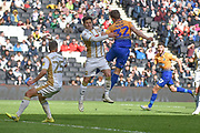 Mansfield Town forward Danny Rose (32) heads the ball  at goal under pressure from Milton Keynes Dons defender George Williams (2) during the EFL Sky Bet League 2 match between Milton Keynes Dons and Mansfield Town at stadium:mk, Milton Keynes, England on 4 May 2019.