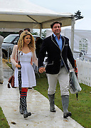 14.JULY.2012 ESSEX<br /> <br /> CELEBRITIES ATTEND A VERY WET AND MUDDY DUKE OF ESSEX POLO MATCH IN ESSEX, UK. MANY OPTED TO COVER THEIR DESIGNER SHOES WITH PLASTIC, OTHERS CAME PREPARED WEARING WELLINGTON BOOTS.<br /> <br /> BYLINE: EDBIMAGEARCHIVE.COM<br /> <br /> *THIS IMAGE IS STRICTLY FOR UK NEWSPAPERS AND MAGAZINES ONLY*<br /> *FOR WORLD WIDE SALES AND WEB USE PLEASE CONTACT EDBIMAGEARCHIVE - 0208 954 5968*
