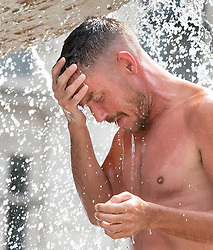 © Licensed to London News Pictures. 26/07/2018. London, UK. A man cools off in the Trafalgar Square fountains as London experiences the hottest day of the year so far. Photo credit: Peter Macdiarmid/LNP