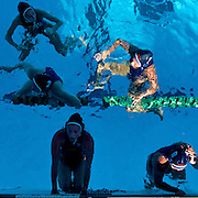 Orange Coast College Water Polo players Sini White (#4), Lexi Heyerly (#2), Taylor Madsen (#7), Laurin Semmelroth (#13), and Shawna Kedzie (#8) take a break during a time out. Orange Empire Conference Water Polo Championships. November 3rd, 2016, 10:20am — Orange Coast College vs Saddleback College — Women's Waterpolo — Saddleback College, Mission Viejo, CA<br /> <br /> Photo by Austin Song / Sports Shooter Academy