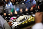 "Garment workers queue up at a factory canteen in Zhongshan city, China. .This picture is part of a photo and text story on blue jeans production in China by Justin Jin. .China, the ""factory of the world"", is now also the major producer for blue jeans. To meet production demand, thousands of workers sweat through the night scrubbing, spraying and tearing trousers to create their rugged look. .At dawn, workers bundle the garment off to another factory for packaging and shipping around the world..The workers are among the 200 million migrant labourers criss-crossing China.looking for a better life, at the same time building their country into a.mighty industrial power."