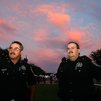 Orange County Sheriffs Officers stand by in the free protest area as the sun begins to set, prior to the trial of George Zimmerman at the Seminole County Courthouse, Saturday, July 13, 2013, in Sanford, Fla. Zimmerman had been charged for the 2012 shooting death of Trayvon Martin. Zimmerman was found not guilty by a jury of six women. (AP Photo/Alex Menendez)