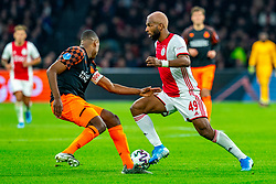 Ryan Babel #49 of Ajax, Denzel Dumfries #22 of PSV Eindhoven in action during the match between Ajax and PSV at Johan Cruyff Arena on February 02, 2020 in Amsterdam, Netherlands