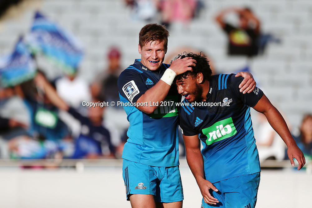 TJ Faiane celebrates with teammate Piers Francis after scoring a try later ruled disallowed. Super Rugby match, Blues v Force at Eden Park, Auckland, New Zealand. 1 April 2017 © Copyright Photo: Anthony Au-Yeung / www.photosport.nz