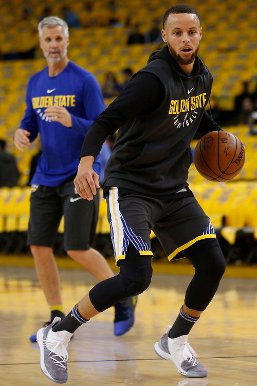 Golden State Warriors guard Stephen Curry (30) practices with assistant coach Bruce Fraser before the start of Game 2 of the NBA Western Conference semifinals between the Golden State Warriors and New Orleans Pelicans at Oracle Arena, Tuesday, May 1, 2018, in Oakland, Calif.