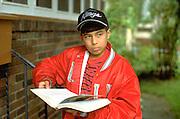 Hispanic young teen age 12 thinking about bible verse.  St Paul Minnesota USA