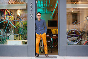 Portrait of bicycle store owner Michael Dinh.<br />
