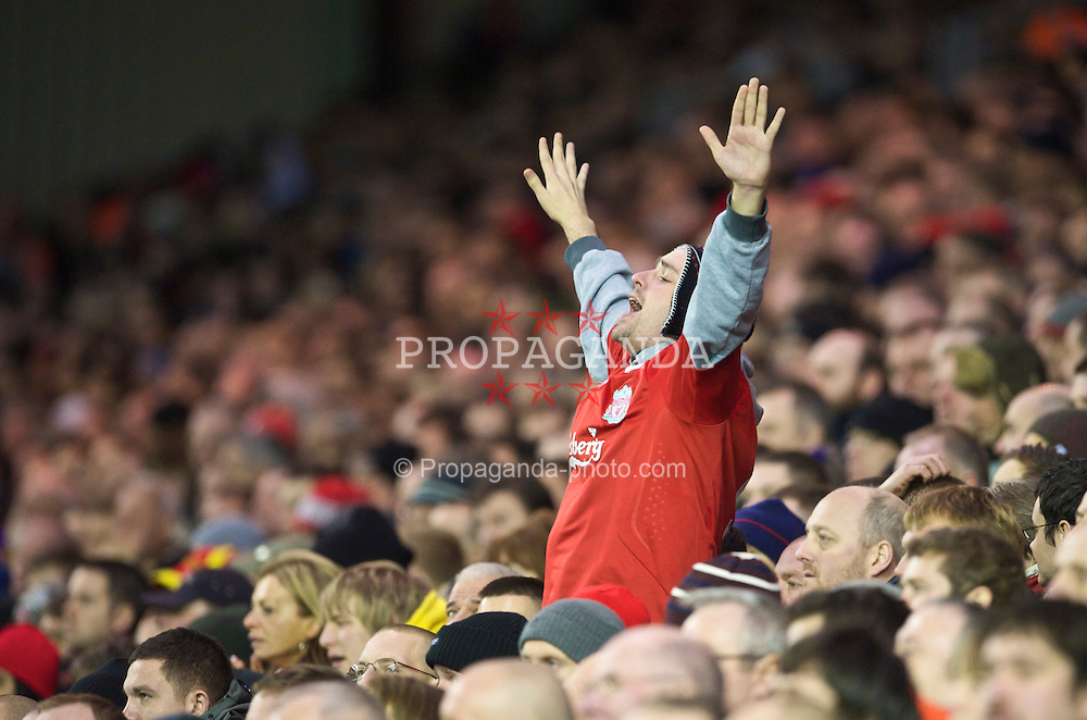 LIVERPOOL, ENGLAND - Saturday, December 26, 2009: A Liverpool supporter on the Spion Kop during the Premiership match against Wolverhampton Wanderers at Anfield. (Photo by: David Rawcliffe/Propaganda)
