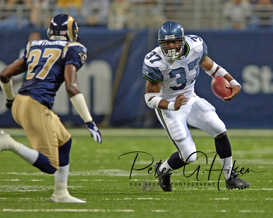 Seattle running back Shaun Alexander (37) looks up field as St. Louis free safety Michael Hawthorne (27) moves in, during game action at the Edward Jones Dome in St. Louis, Missouri, October 9, 2005.  The Seahawks beat the Rams 37-31.