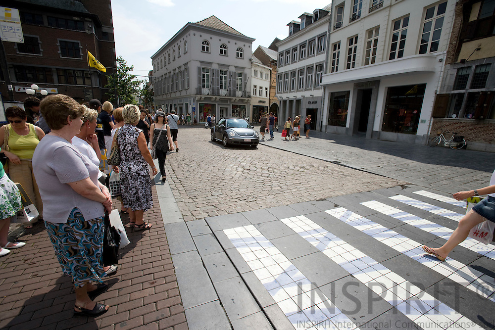HASSELT - BELGIUM - 02 JULY 2008 --  The city of Hasselt has introduced a free public transport service since 1. July 1997. Here people waiting at the Grote Markt (Town square) for the Centrumpendel bus. Photo: Erik Luntang..
