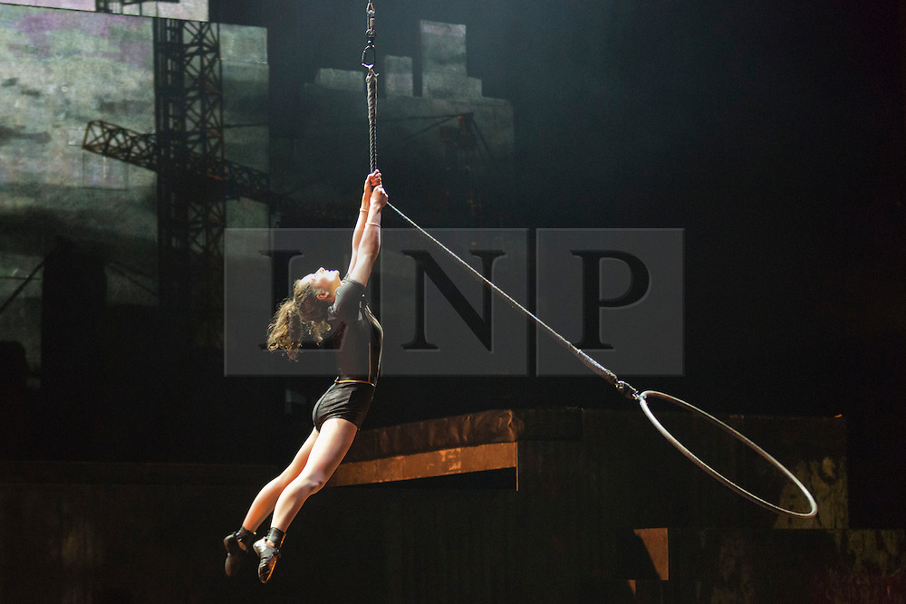 """© Licensed to London News Pictures. 30/09/2013. London, England. Pictured: Justine Méthé-Crozat on the aerial hoop. The 15 performers from the Canadian troupe Cirque Éloize perform their show """"iD"""" at London's Peacock Theatre from 1 to 19 October 2013. """"iD"""" is a blend of circus arts and urban dance. Photo credit: Bettina Strenske/LNP"""