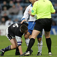 Dundee v St Johnstone...12.11.05<br />Ref Craig MacKay separates Barry Smith and Darren Sheridan<br /><br />Picture by Graeme Hart.<br />Copyright Perthshire Picture Agency<br />Tel: 01738 623350  Mobile: 07990 594431