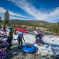 Visitors enjoy the newly-made snow during opening day at Big Bear Snowplay in Big Bear City, Sunday, Nov. 19, 2017. The local temperatures from the night time mid 20's to mid 50's in the day have made for Big Bear Snowplay to make from 6 inches to 2 1/2 foot base. Snowplay will continue to make new snow every night along with other mountain recreation areas and resorts. (Eric Reed/For The OC Register/SCNG)