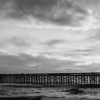 Balboa Pier black and white panorama photo in Newport Beach California. Newport Beach is a popular coastal beach city along the Pacific Ocean in Orange County Southern California. Panoramic photo ratio is 1:3. Copyright ⓒ 2017 Paul Velgos with All Rights Reserved.