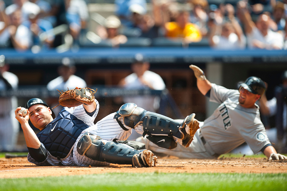 NEW YORK - JULY 27: Russell Martin #55 of the New York Yankees lays on the ground after attempting to tag out Josh Bard #3 of the Seattle Mariners during the game against the Seattle Mariners at Yankee Stadium on July 27, 2011 in the Bronx borough of Manhattan. (Photo by Rob Tringali) *** Local Caption *** Russell Martin, Josh Bard