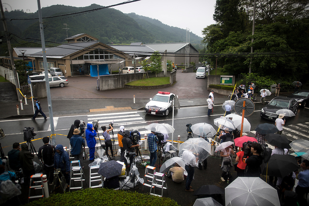 SAGAMIHARA, JAPAN - JULY 26 :  Media waiting in front of the main gate of Tsukui Yamayuri-en building at Sagamihara on Wednesday, July 26, 2016 in Kanagawa prefecture, Japan. Police arrested 26 year old Satoshi Uematsu after breaking inside the building facility for handicapped and killing 19 people and injuring 20 in the city of Sagamihara, west of Tokyo. (Photo: Richard Atrero de Guzman/NURPhoto)