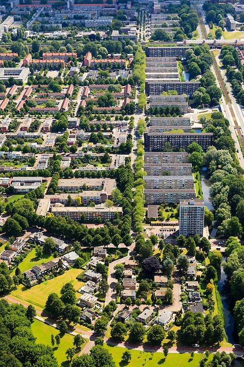 Nederland, Noord-Holland, Amsterdam, 14-06-2012; Slotervaart met de flats aan de Comeniusstraat, trambaan op de Cormelis Lelylaan..De wijk is onderdeel van de Westelijke Tuinsteden, gerealiseerd op basis van het Algemeen Uitbreidingsplan voor Amsterdam (AUP, 1935). Voorbeeld van het Nieuwe Bouwen, open bebouwing in stroken, langwerpige bouwblokken afgewisseld met groenstroken. .View on one of the western garden cities of Amsterdam Slotervaart.   Constructed on the basis of the General Extension Plan for Amsterdam (AUP, 1935). Example of the New Building (het Nieuwe Bouwen), detached in strips, oblong housing blocks alternated with green areas, built in fifties and sixties of the 20th century. .Straight tramway (r)..luchtfoto (toeslag), aerial photo (additional fee required).foto/photo Siebe Swart