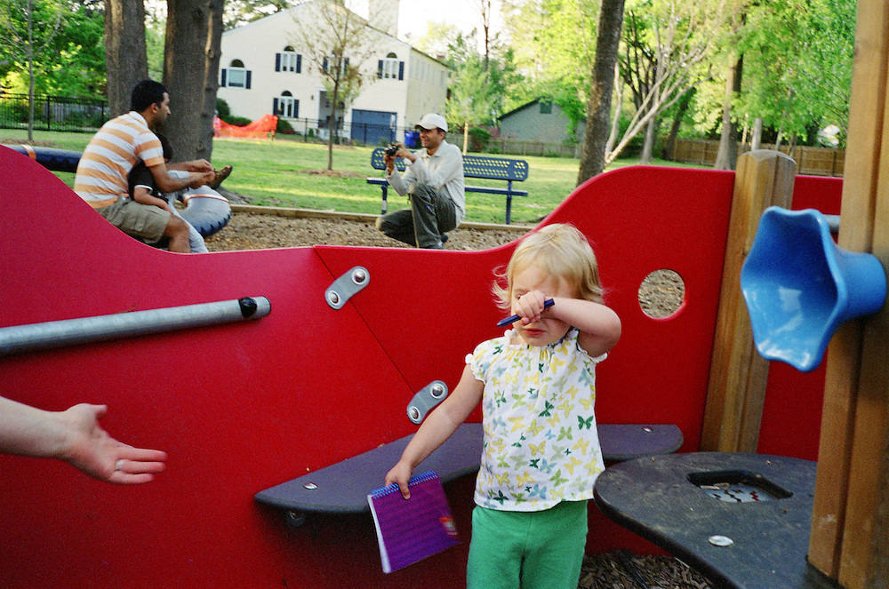 Melissa Eich, 22, reaches out to her daughter Madelyn, 2, as they spend time together at a playground in Norfolk, Virginia on Saturday, April 17, 2010.