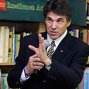 Mercedes, TX / 2006 - Texas governor Rick Perry announced that Mercedes High School will receive $180,000 for staff bonuses to reward teaching excellence. The funds are part of a $10 million program for merit-based incentives. Here, Perry speaks to Mercedes High School faculty, administrators and members of the student council about the grant. Photo by Mike Roy / The Monitor